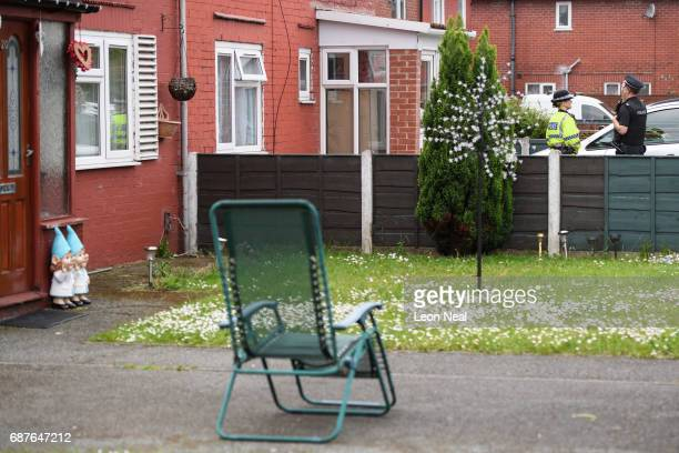 Garden gnomes are seen as police officers guard the location of a building where it is believed a number of arrests were made in connection with...