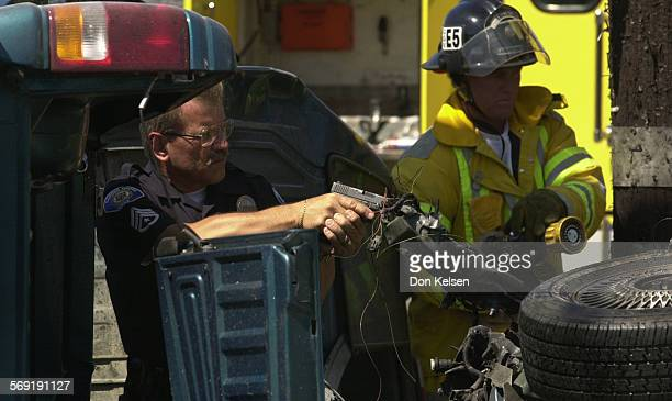 Garden Grove Police officer works alongside Garden Grove firefighter at two vehicle crash involving suspects in two bank holdups in Garden Grove...