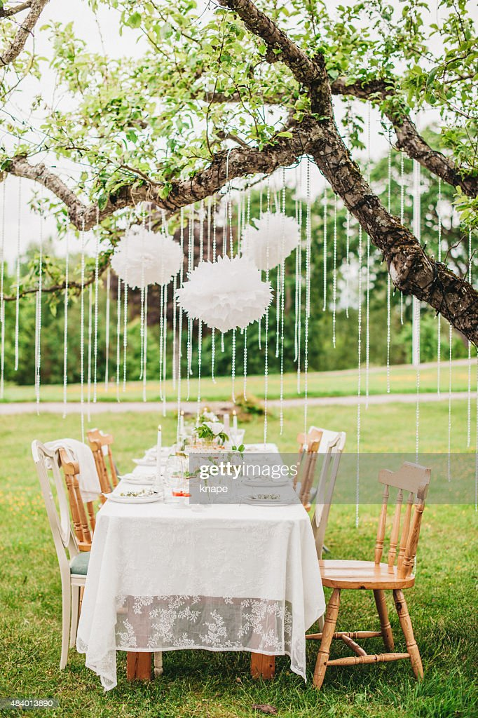 Garden Party Arrangement With Decorations Hanging From