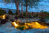 Decorative koi pond in a garden at night
