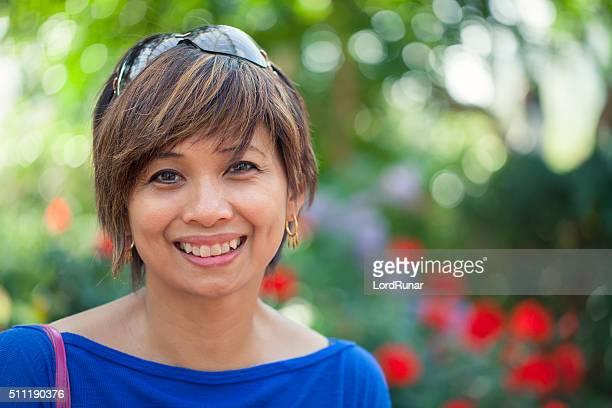 Jardim Retrato de uma mulher sorridente