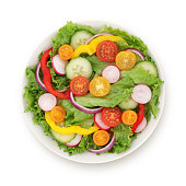 Garden vegetables salad with cherry tomatos, bell peppers, cucumber, radish and red onion -  isolated on white (excluding the shadow)