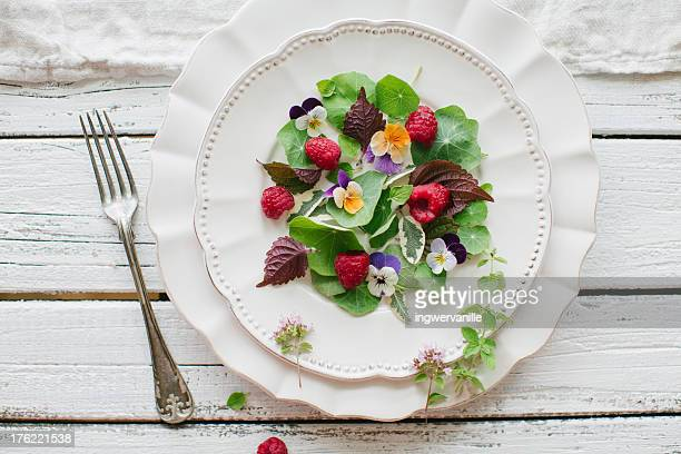 Garden salad with raspberries