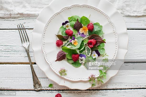 Garden salad with raspberries