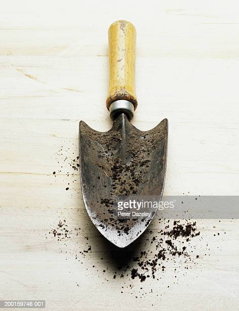 Garden spade covered with soil, elevated view