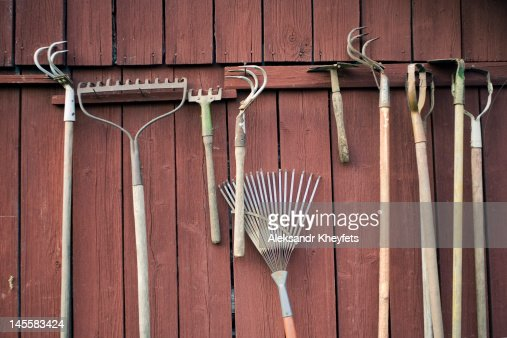 Garden tools hanging on rural shed