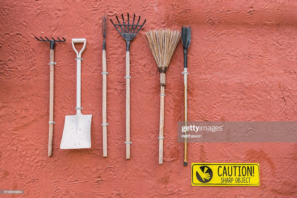 Garden Tools Hanging On The Res Wall With Vintage Feel : Stock Photo