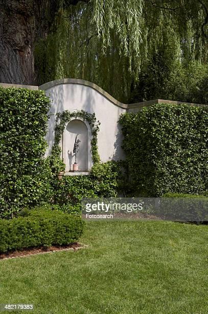 Garden wall with niche statue