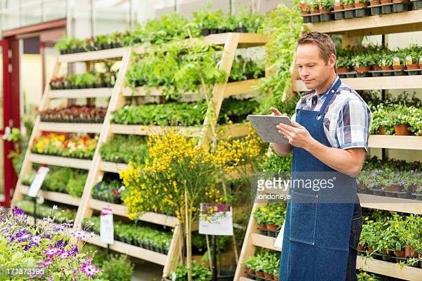 Garden Worker Using Digital Tablet