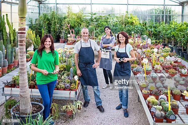 Garden workers standing in greenhouse