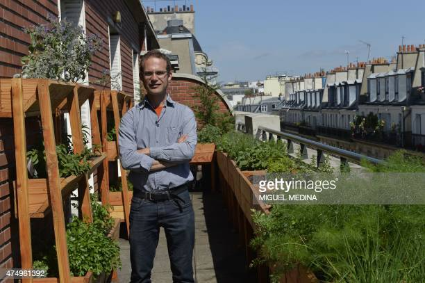 Gardener and founder of the Topager company specialized in urban vegetable gardens Nicolas Bel poses on May 18 2015 on the rooftop of the Ferrandi...
