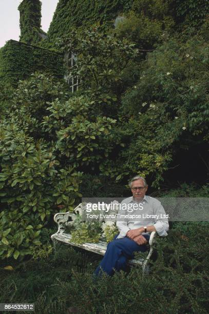 Gardener and rose breeder Keith Steadman sitting on a bench in a backyard 1981