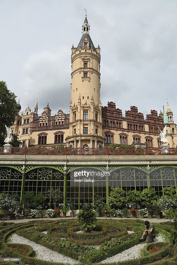 A gardener clips a tiny hedge in the gardens at Schloss Schwerin castle seat of the state parliament of the state of MecklenburgWestern Pomerania and...