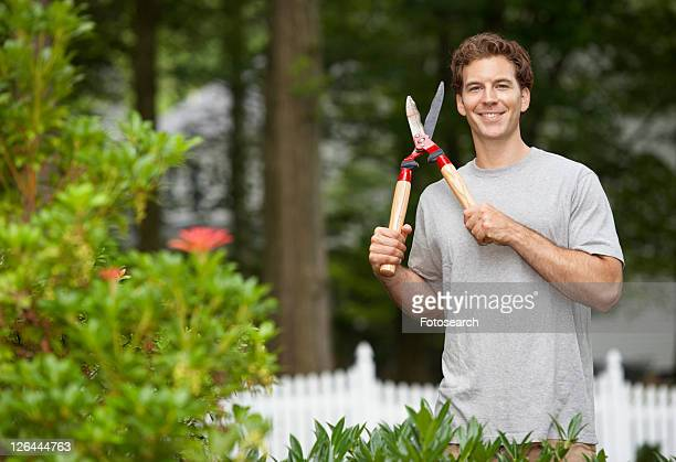Gardener holding hedge clippers