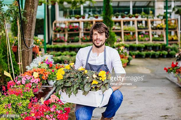 Gardener in a flower nursery
