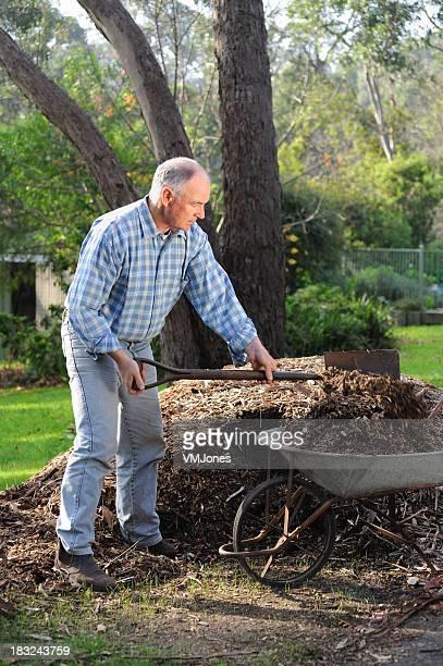 Gardener Mulching Garden