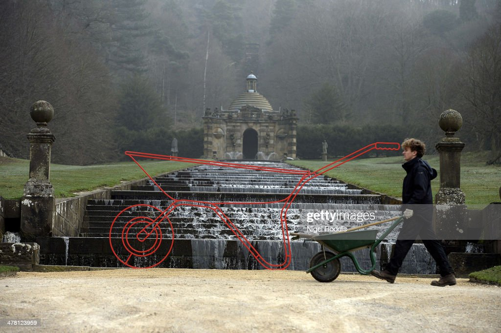 A gardener walks past Wheelbarrow, by artist Michael Craig-Martin, which is part of a new exhibition of his work at Chatsworth House on March 12, 2014 in Chatsworth, England. Chatsworth House reopens after a winter break on Sunday 16th March