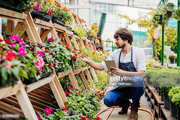Gardener with digital tablet