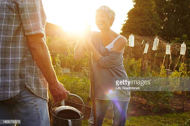Gardeners laughing together on allotment