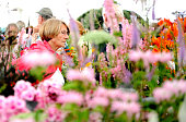 Gardening enthusiasts attend the RHS Flower Show at Tatton Park on July 21 2016 in Knutsford England