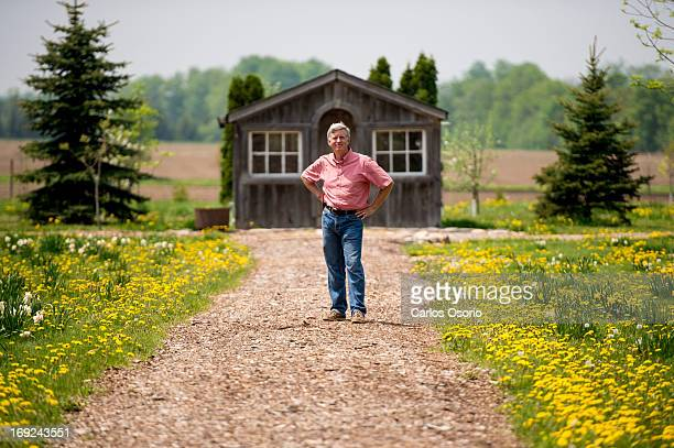Gardening expert Mark Cullen poses for a photograph in the backyard of his home