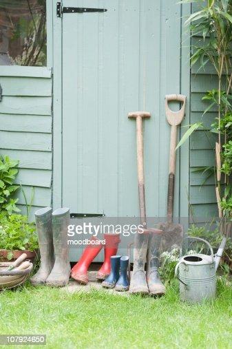 Gardening tools at door of potting shed
