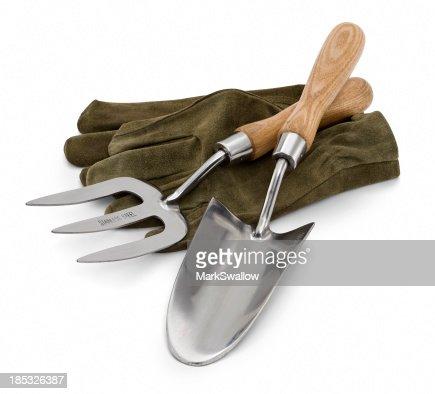 Gardening tools laying on green gardening gloves