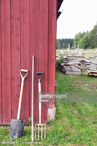 Gardening tools outside barn at farm
