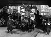 A 'gardenseat' horsedrawn tram going under the railway bridge at Ludgate Hill London