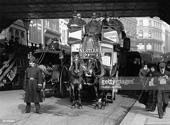 A 'gardenseat' horsedrawn tram going under the railway bridge at Ludgate Hill London
