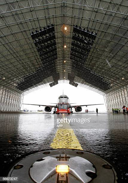 An aircraft is taxied through a special hangar before being deiced by infrared heat waves at Oslo airport 18 January 2006 The special hangar for...