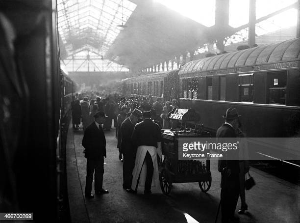 Gare Saint Lazare and passengers about to board the train in December 1929 in Paris France