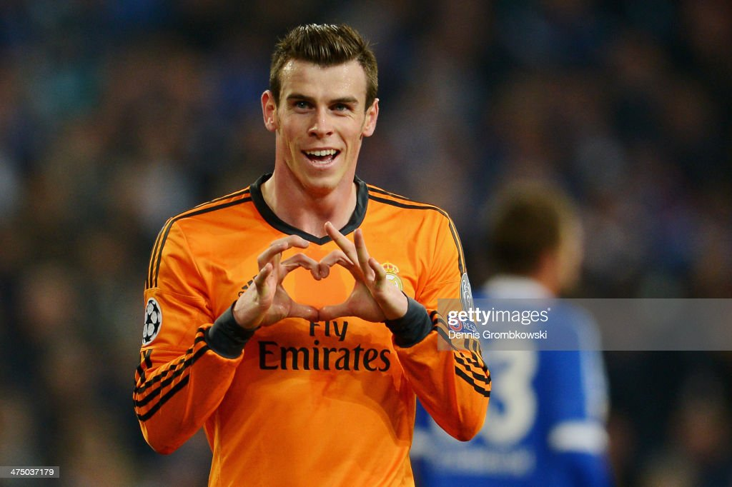 Gareht Bale of Real Madrid celebrates after scoring his team's second goal during the UEFA Champions League Round of 16 first leg match between Schalke 04 and Real Madrid CF at Veltins-Arena on February 26, 2014 in Gelsenkirchen, Germany.