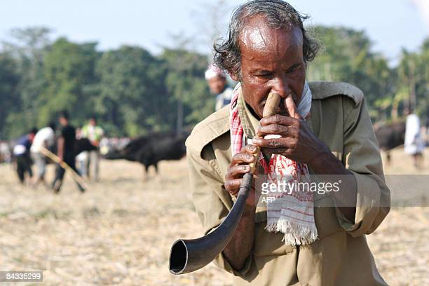 Gareswar Gaokhowa plays a 'pepa' an Assamese traditional musical instrument made from buffalo horn during the Bhogali Bihu Festival in Barapujia some...