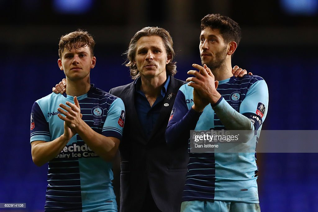Gareth Ainsworth (C), Manager of Wycombe Wanderers consoles Dominic Gape (L) and Joe Jacobson (R)during the Emirates FA Cup Fourth Round match between Tottenham Hotspur and Wycombe Wanderers at White Hart Lane on January 28, 2017 in London, England.