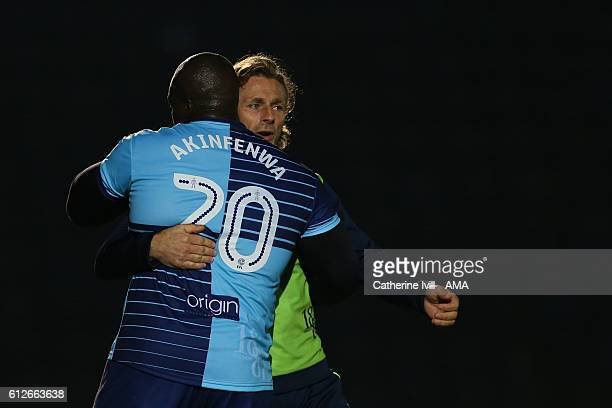 Gareth Ainsworth manager of Wycombe Wanderers hugs Adebayo Akinfenwa of Wycombe Wanderers during the Checkatrade trophy match between Wycombe...