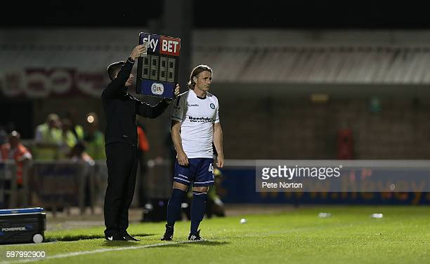 Gareth Ainsworth of Wycombe Wanderers prepares to enter the the pitch as a substitute during the checkatradecom Trophy match between Northampton Town...