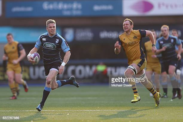 Gareth Anscombe of Cardiff bursts clear of Nick Koster of Bristol to scores his sides second try during the European Rugby Challenge Cup Pool 4 match...