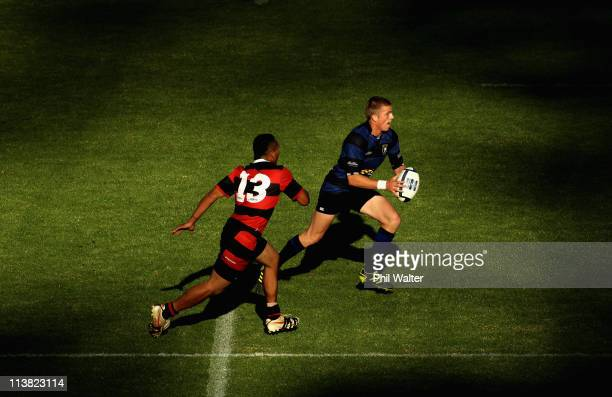 Gareth Anscombe of Ponsonby runs the ball past Tafolea Mohetau of Otahuhu during the Alan McEvoy Trophy game between Ponsonby and Otahuhu at Western...