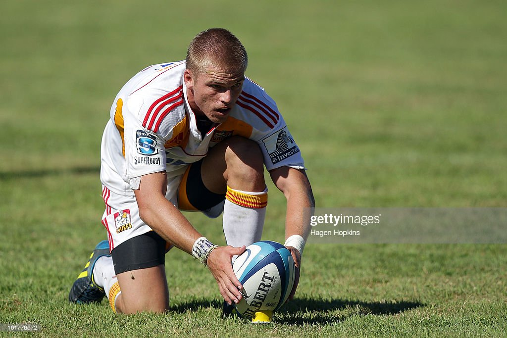 Gareth Anscombe of the Chiefs lines up a kick during the Super Rugby trial match between the Hurricanes and the Chiefs at Mangatainoka RFC on February 16, 2013 in Mangatainoka, New Zealand.