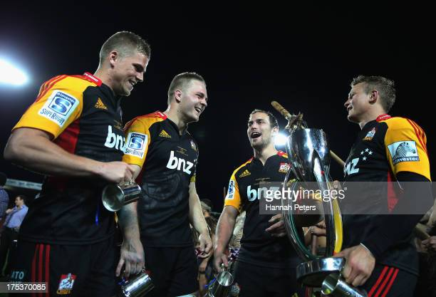 Gareth Anscombe Sam Cane Andrew Horrell and Robbie Robinson of the Chiefs celebrate after winning the Super Rugby Final match between the Chiefs and...