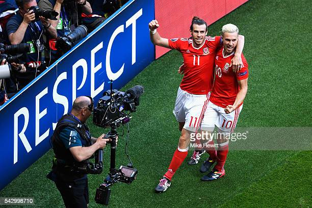 Gareth Bale and Aaron Ramsey of Wales celebrate their team's first goal during the UEFA EURO 2016 round of 16 match between Wales and Northern...