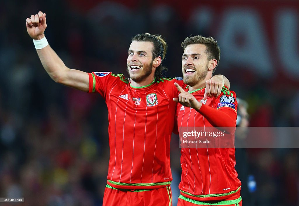 Gareth Bale and Aaron Ramsey of Wales celebrate victory after the UEFA EURO 2016 qualifying Group B match between Wales and Andorra at Cardiff City...