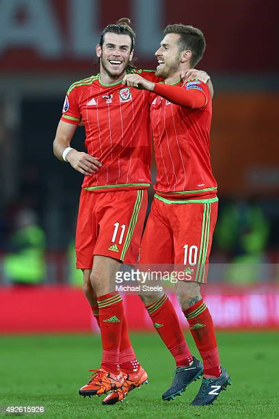 Gareth Bale and Aaron Ramsey of Wales celebrate victory after the UEFA EURO 2016 qualifying Group B match between Wales and Andorra during the UEFA...