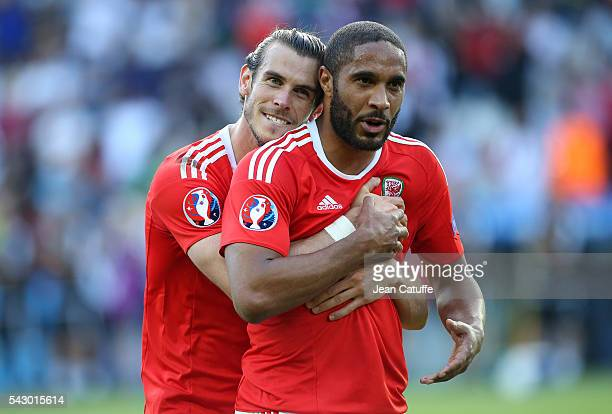 Gareth Bale and Ashley Williams of Wales celebrate the victory following the UEFA EURO 2016 round of 16 match between Wales and Northern Ireland at...