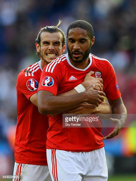 Gareth Bale and Ashley Williams of Wales celebrate their team's 10 win in the UEFA EURO 2016 round of 16 match between Wales and Northern Ireland at...
