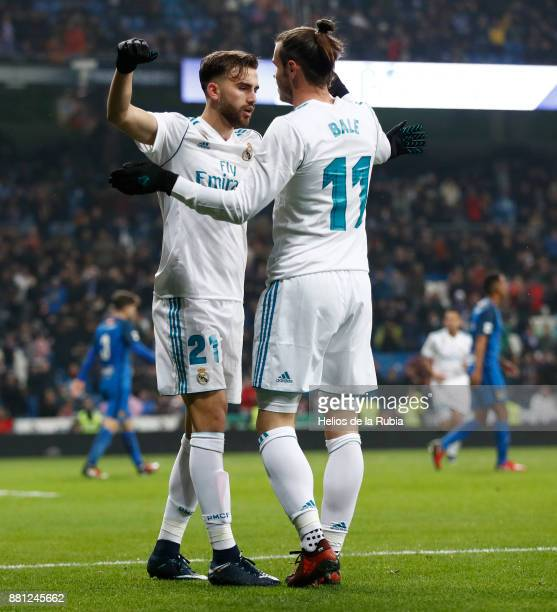 Gareth Bale and Borja Mayoral of Real Madrid celebrate after scoring during the Copa del Rey round of 32 second leg match between Real Madrid CF and...