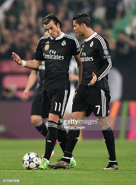 Gareth Bale and Cristiano Ronaldo of Real Madrid CF in discussion as Alvaro Morata of Juventus scores their first goal during the UEFA Champions...