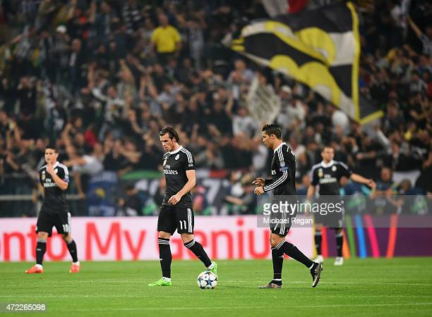 Gareth Bale and Cristiano Ronaldo of Real Madrid CF look dejected as Alvaro Morata of Juventus scores their first goal during the UEFA Champions...