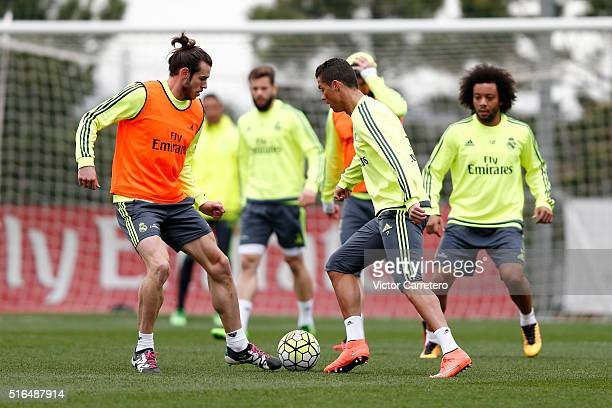 Gareth Bale and Cristiano Ronaldo of Real Madrid in action during a training session at Valdebebas training ground on March 19 2016 in Madrid Spain